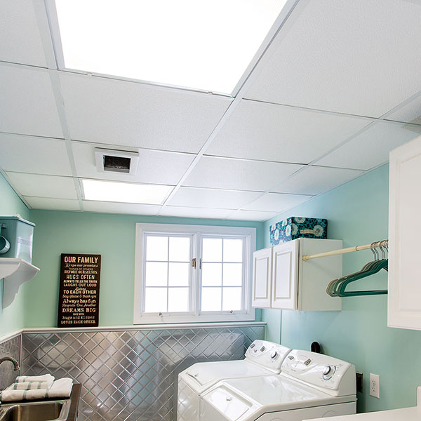 A pristine. clean laundry room DIY ceiling project
